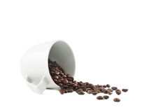 Spilled coffee beans from the cup isolated Stock Photography