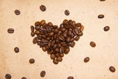 Spilled coffee beans. Coffee in the form of hearts. stock photo