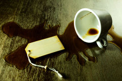 Spilled coffee with room for text. Spilled coffee from a white cup on a grunge table with room for text Stock Photos