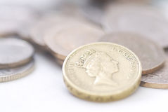 Spilled coins, focus on �1 coin. Royalty Free Stock Photos