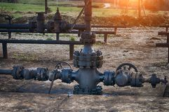 Oil field. Spilled crude oil around oil field. Oil and Gas Industry Royalty Free Stock Images