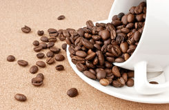 Spilled cup of coffee. Beans stock photo