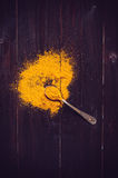 Spilled curry powder and spoon Royalty Free Stock Photo