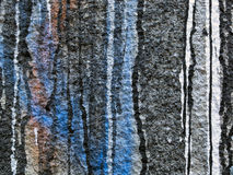 Spilled,dripping paint on a grey wall Royalty Free Stock Photography