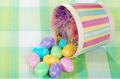 Spilled easter eggs and basket Stock Photos