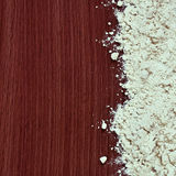 Flour on the wooden background Royalty Free Stock Photo