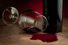 Spilled glass of wine on table after party Stock Images