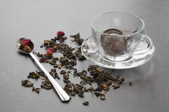 Spilled green tea with a rose on stone table stock photography