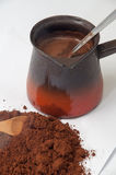 Spilled ground coffee and boiled coffee in coffee pots Royalty Free Stock Photo