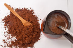 Spilled ground coffee and boiled coffee in coffee pots Royalty Free Stock Images
