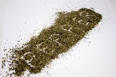 Spilled ground pepper. On the white background stock photography