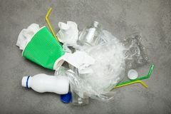 Spilled household garbage. The concept of ecology and recycling royalty free stock image