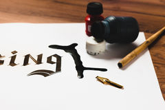 Spilled ink on paper. Calligraphy error stock image