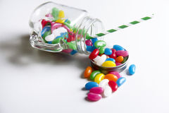 Spilled jelly beans. A jar spilling jelly beans Stock Image