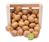 Spilled kiwifruits in wooden crate Royalty Free Stock Photo