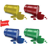 Spilled liquid. Metal multicolored barrels. Steel cans. Stock Image