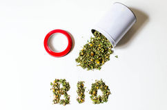 Spilled loose bio tea pot with a red lid Royalty Free Stock Image