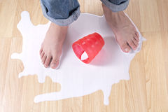 Spilled milk Stock Photo