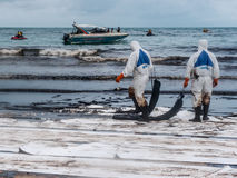 Spilled oil cleaning at the beach, Rayong, Thailand 1 Royalty Free Stock Photo
