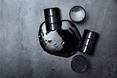 Spilled oil drums Stock Images
