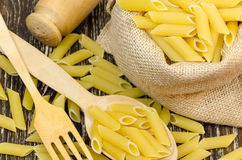 Spilled pasta from durum wheat. Italian cuisine healthy eating Royalty Free Stock Images