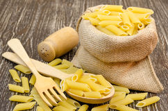 Spilled pasta from durum wheat. Italian cuisine healthy eating royalty free stock photo