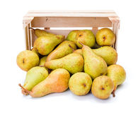 Spilled pears from wooden crate Royalty Free Stock Photo