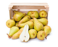 Spilled pears from wooden crate Royalty Free Stock Photos