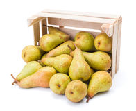 Spilled pears from wooden crate Stock Photos