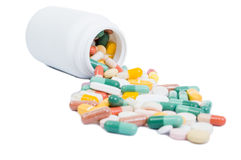 Spilled pills and open bottle Royalty Free Stock Image