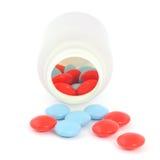 Spilled pills from prescription bottle Stock Image