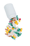 Spilled pills and recipient Stock Photography