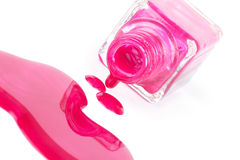 Spilled pink nail polish on white Stock Photos