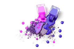 Spilled pink nail polishes bottles on pink eye shadows cosmetic. Isolated on white. Creative cosmetic concept stock photo