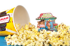 Spilled popcorn. A tub of spilled popcorn surrounds a circus statue of a group of bears playing music and promoting popcorn royalty free stock photos