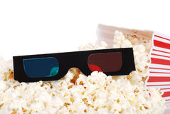 Spilled popcorn with 3D glasses Royalty Free Stock Images