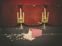 Spilled popcorn on floor in cinema Royalty Free Stock Photography