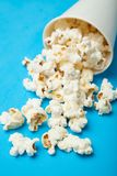 Spilled popcorn from a paper cup.  royalty free stock images