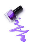Spilled purple nail polish. As sample of cosmetics product isolated on white background Stock Photo
