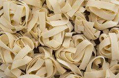 Spilled raw pappardelle pasta Royalty Free Stock Photography