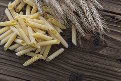 Spilled raw penne pasta Royalty Free Stock Photography