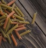 Spilled raw penne pasta Royalty Free Stock Photo