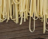 Spilled raw spaghetti pasta Stock Photo