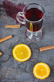 Spilled red mulled wine and orange Stock Photos