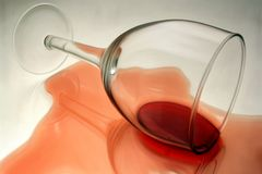 Spilled red wine. Capsized glass with red wine Royalty Free Stock Photos