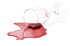 Spilled red wine glass Stock Images