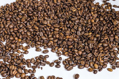 Spilled roasted coffee beans arabica. Agriculture production background Stock Images