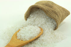 Spilled Rock Salt over wooden spoon. Stock Photography