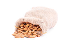Spilled sack of almonds Stock Photo
