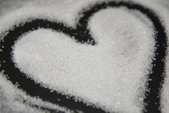 Spilled Sugar Heart Love Shape of Heart Black Background. unhealthy sugar. Love sugar Sweet. Spilled Sugar Heart Love Shape of Heart Black Background. unhealthy stock photography
